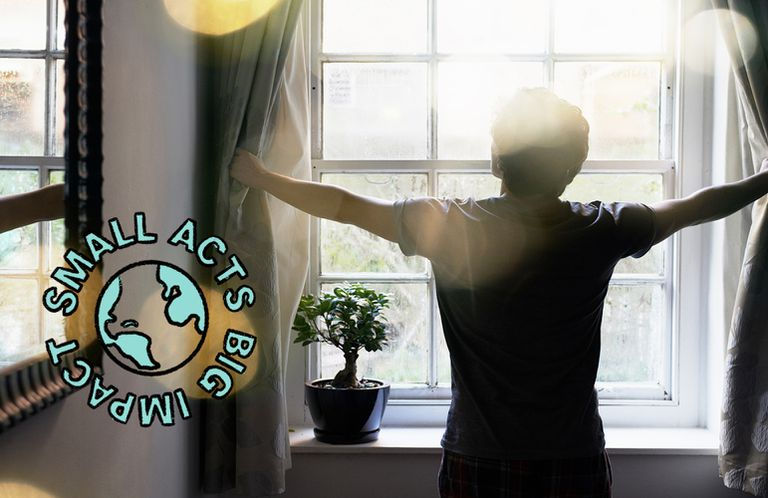 man opening the curtains