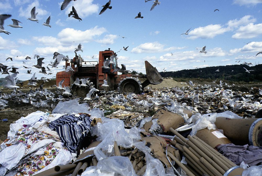 Trash heap under a blue sky