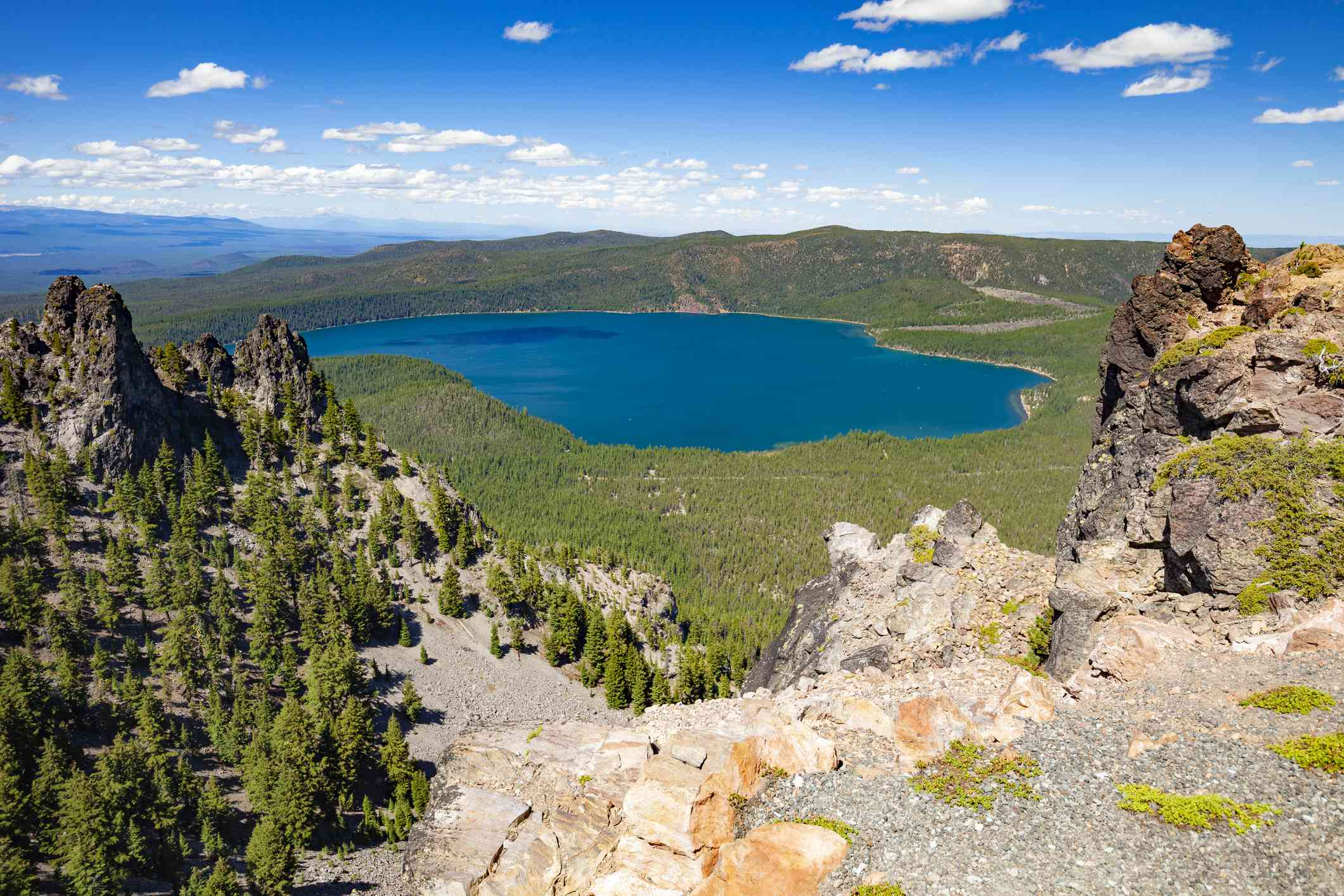 High-angle view of blue lake in Newberry National Volcanic Monument