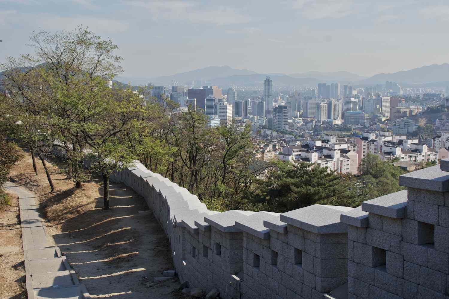Seoul City Wall overlooking the modern cityscape of Seoul