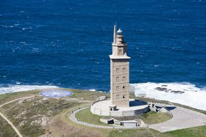 The Tower of Hercules with bright blue water behind it.