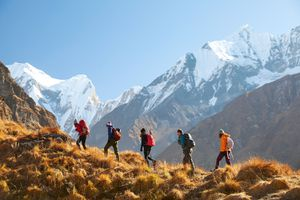Hikers in snow-capped mountains.