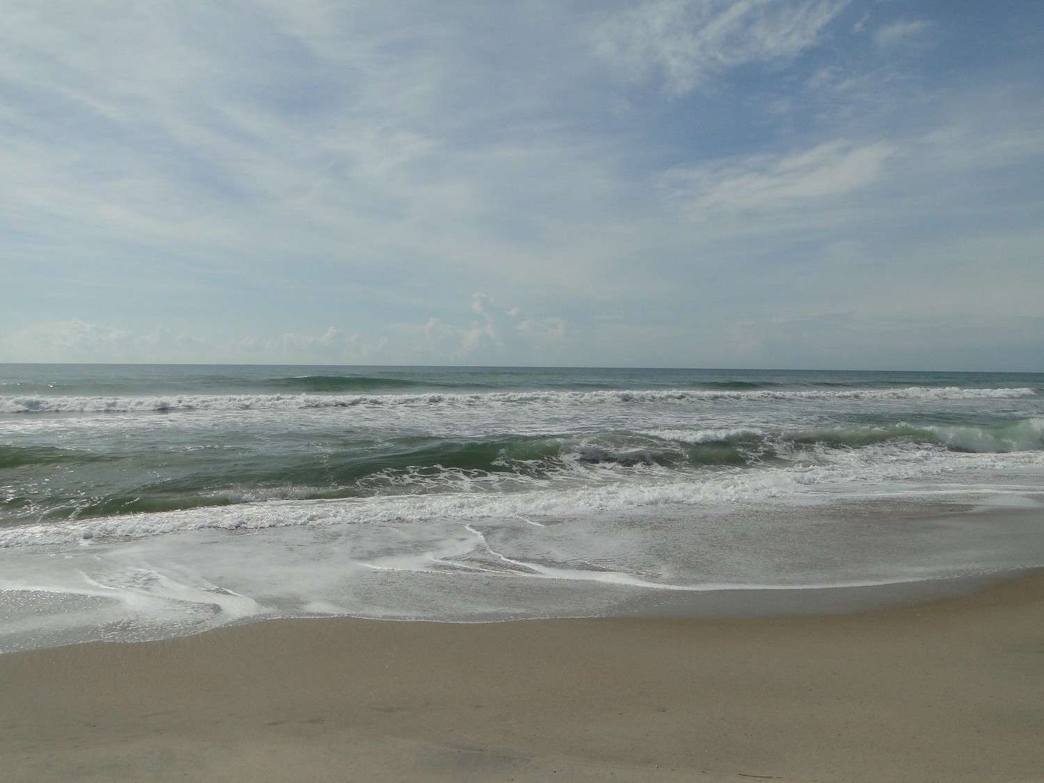 Small waves crash into the beach on Ocracoke Island on the Outerbanks in North Carolina