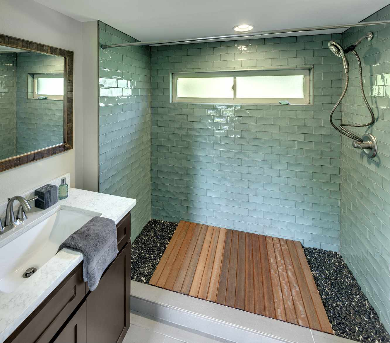 Shower with wooden floor bordered by stones