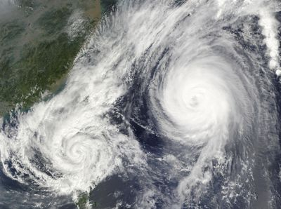 Satellite image of two tropical cyclones interacting.