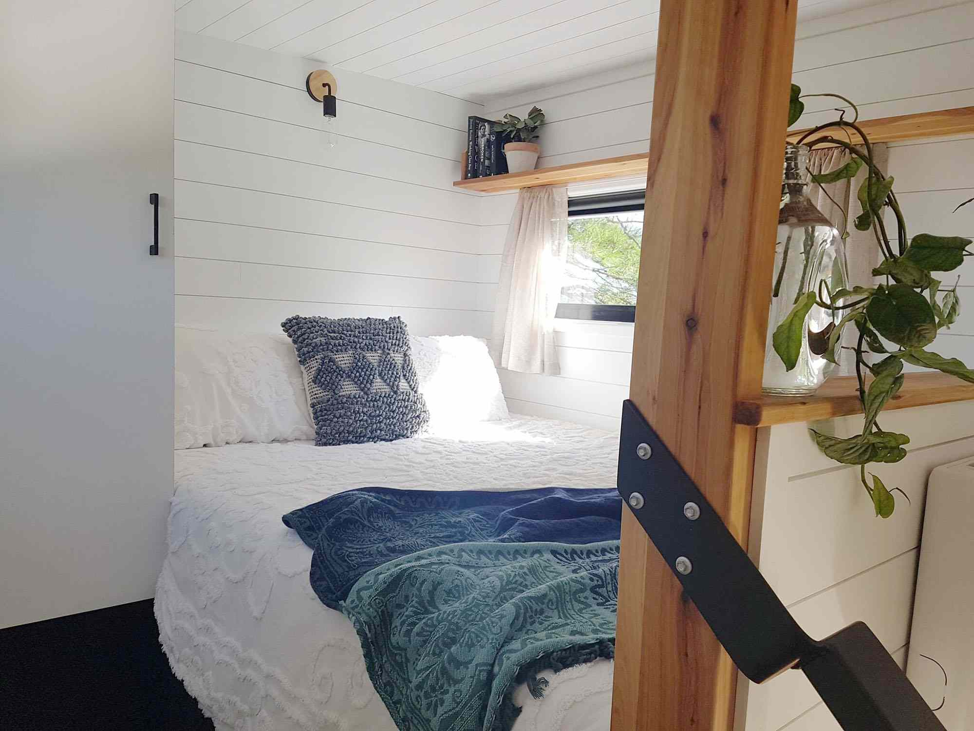 Sojourner Tiny House by Hauslein Tiny House Company bedroom