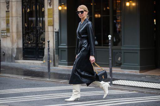 woman wears a black vegan leather dress