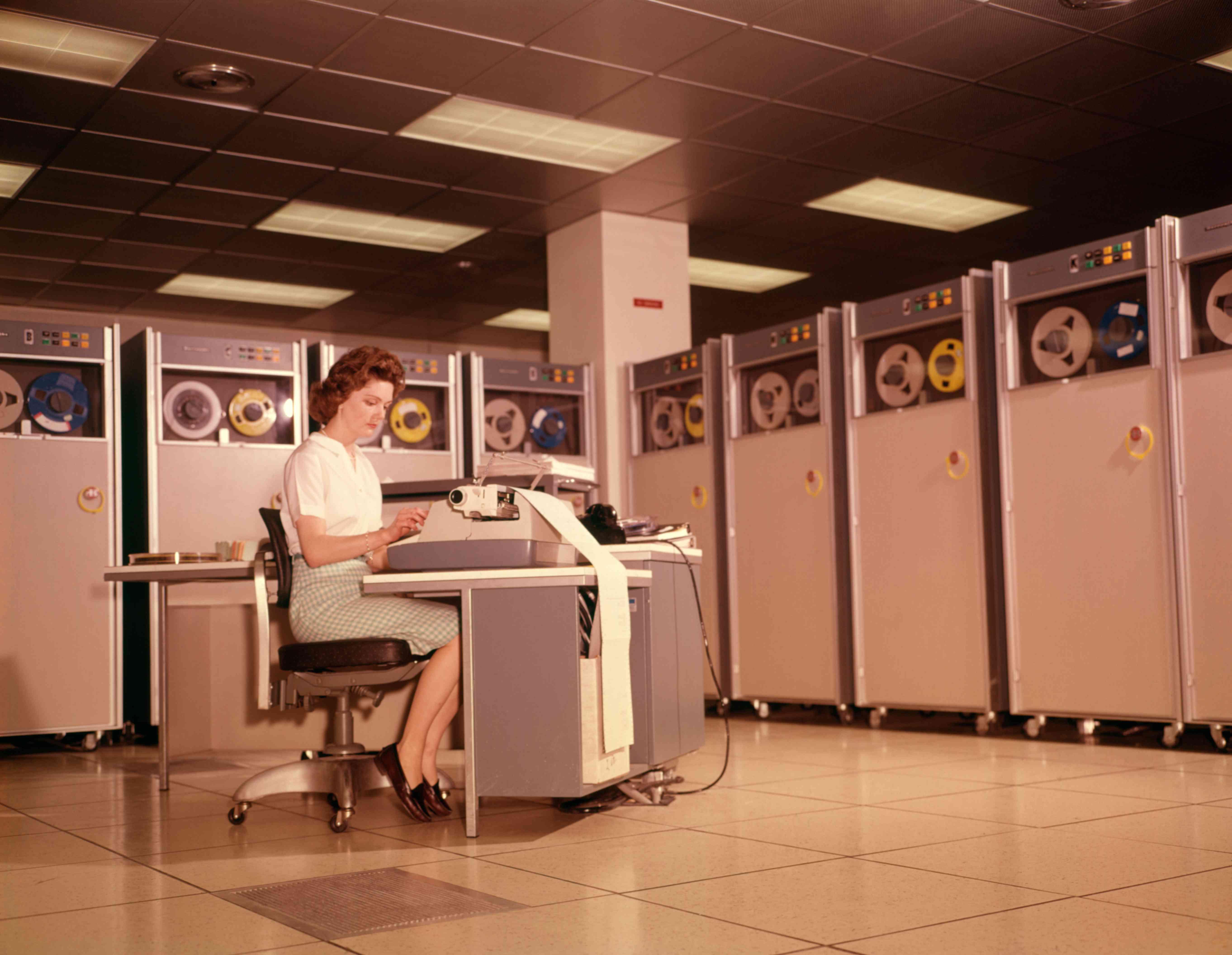 woman running mainframe computer