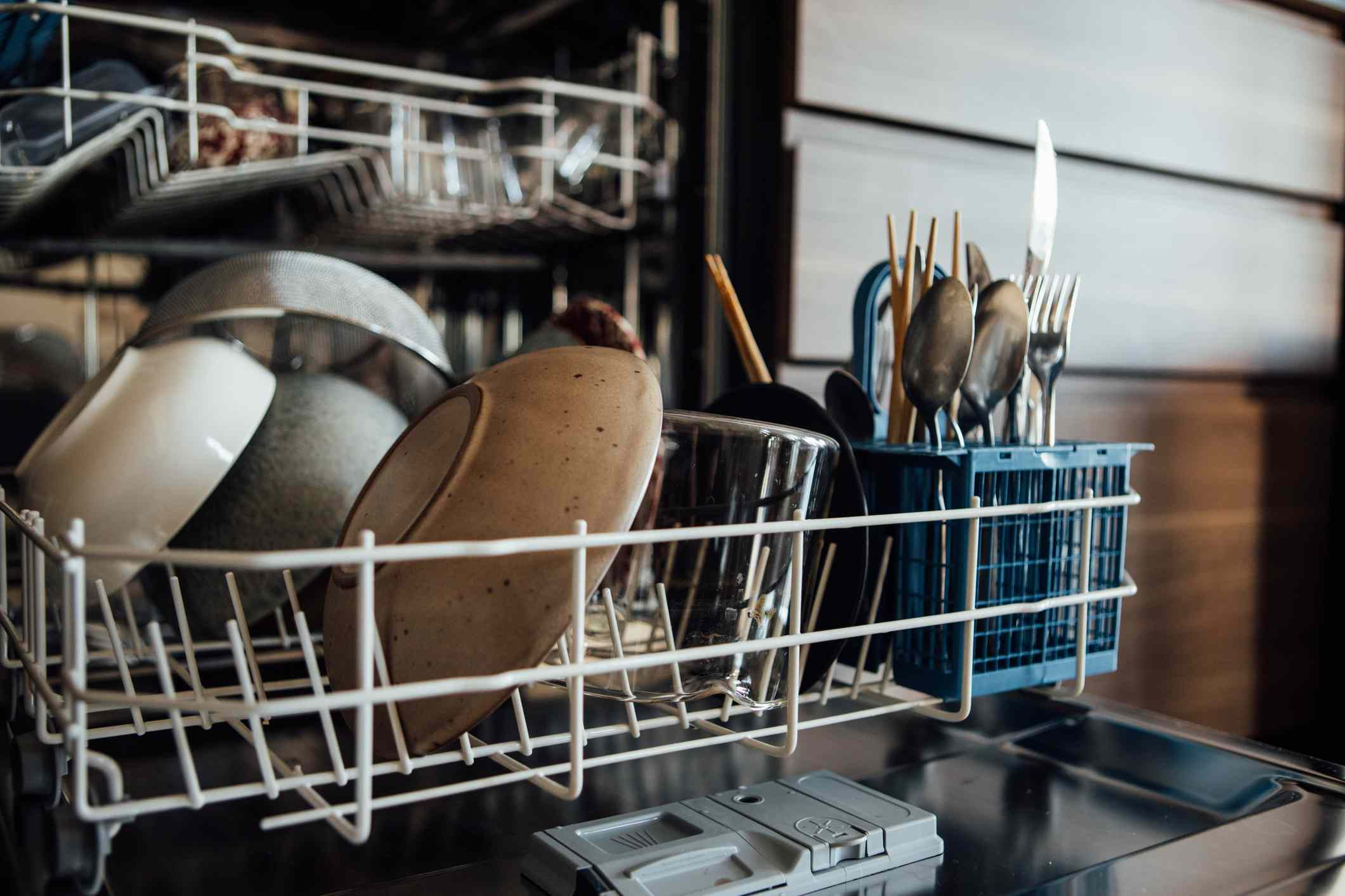 clean dishes in an opened dishwasher