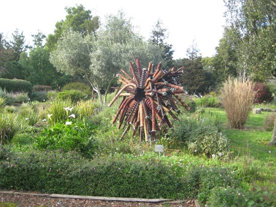Sculpture made out of waste in a garden.