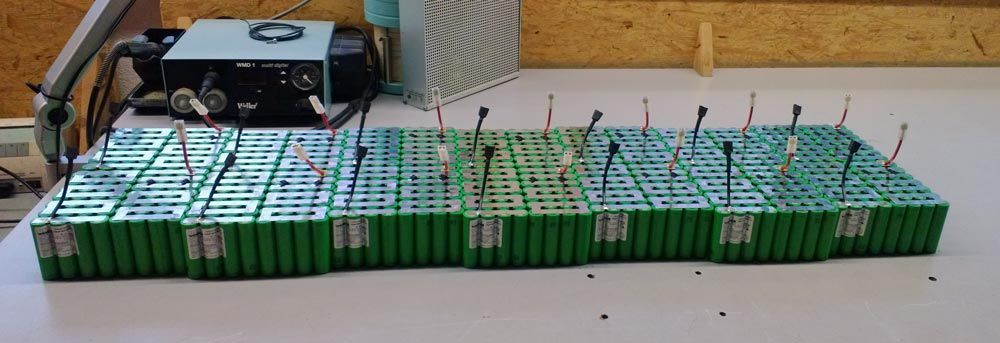 Two battery packs worth of Lithium Ion cells in the packing process