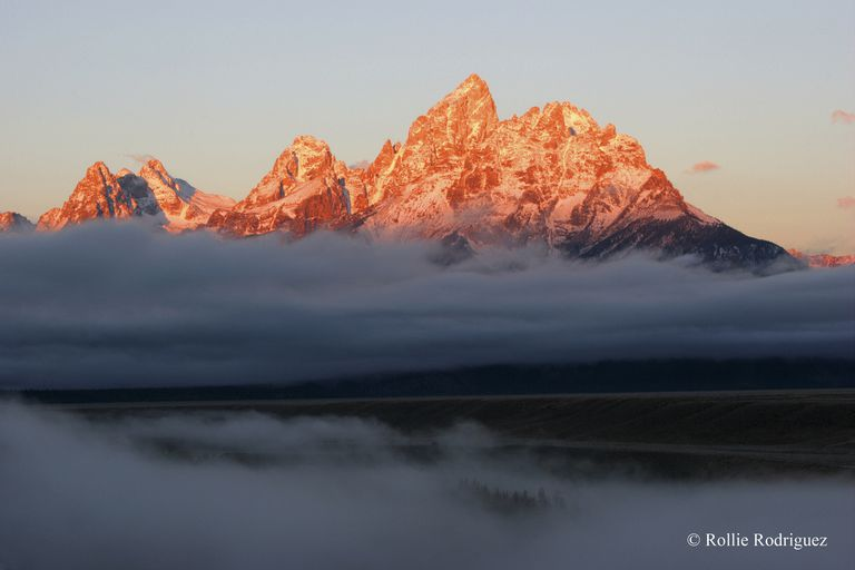Sunrise turning a mountain range orange in early morning light