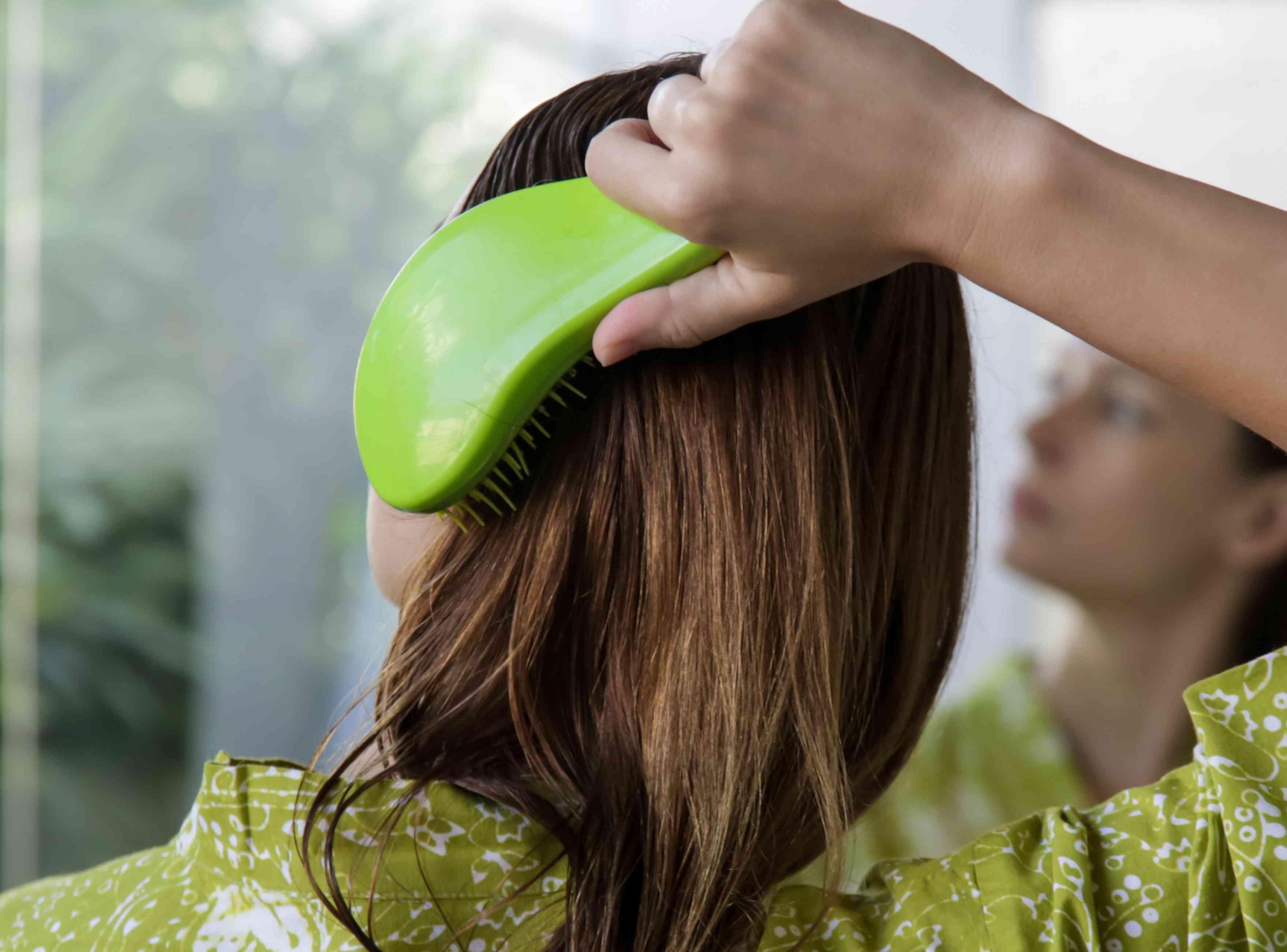 woman detangling hair