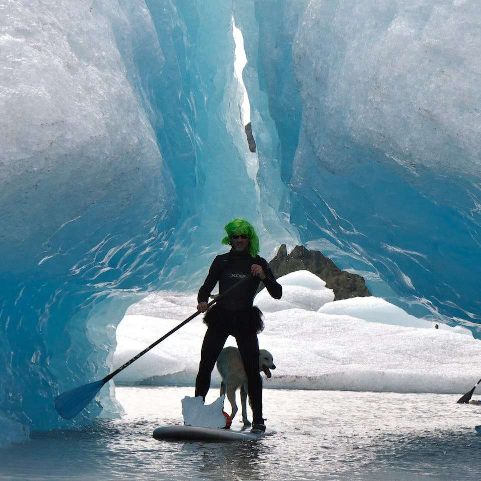 Nanook hangs out with his owner, Scott Swift, at Spencer Glacier, near their home in Alaska