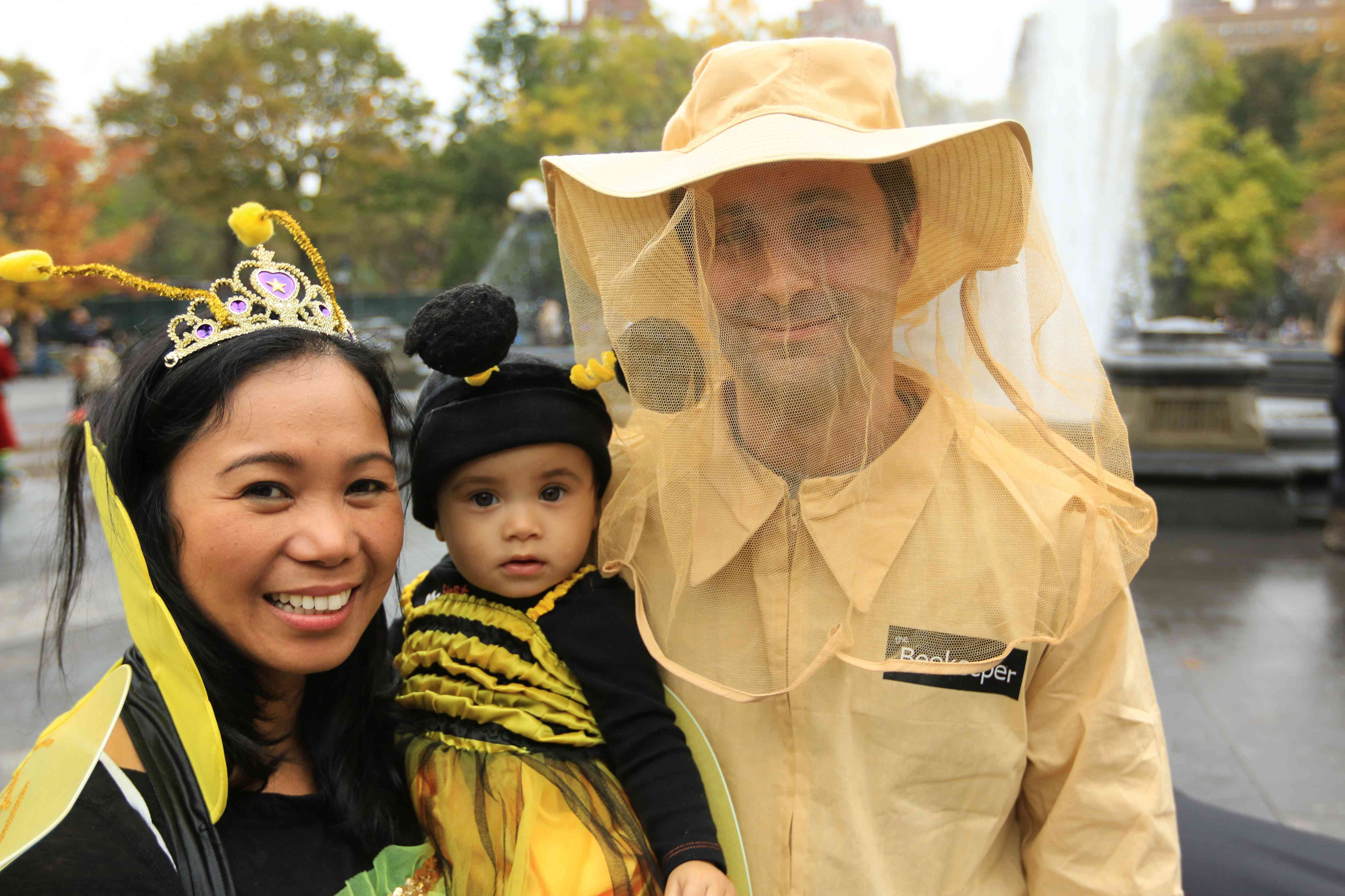 family dressed like bees