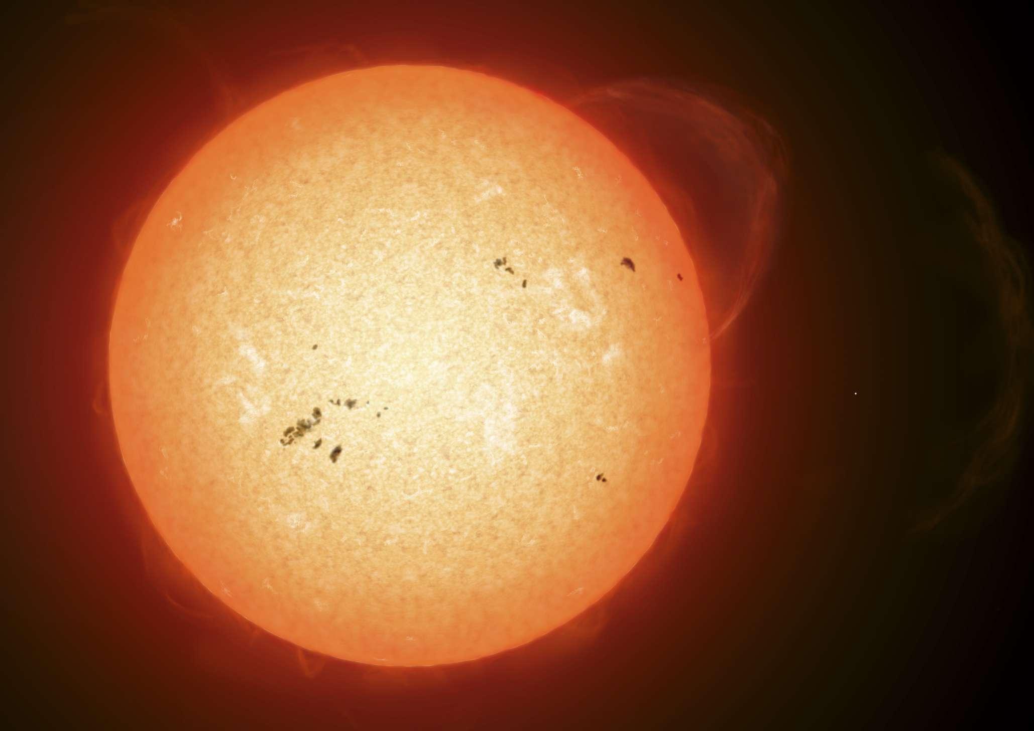 Dark sunspots visible on the Sun's surface.