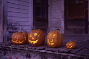Carved jack-o-lanterns on a stoop