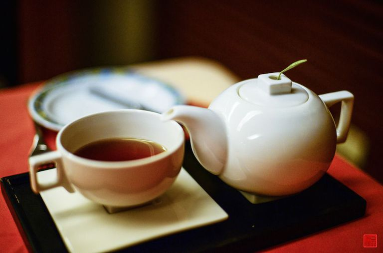Teapot and cup of tea on a table