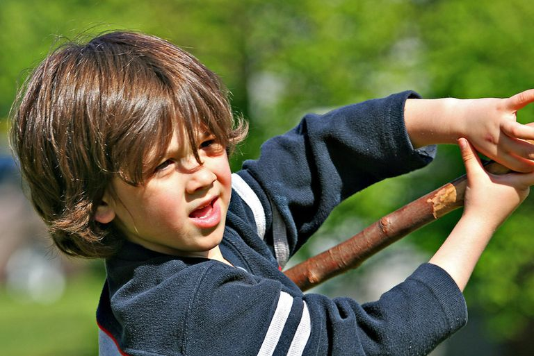 boy playing with a stick