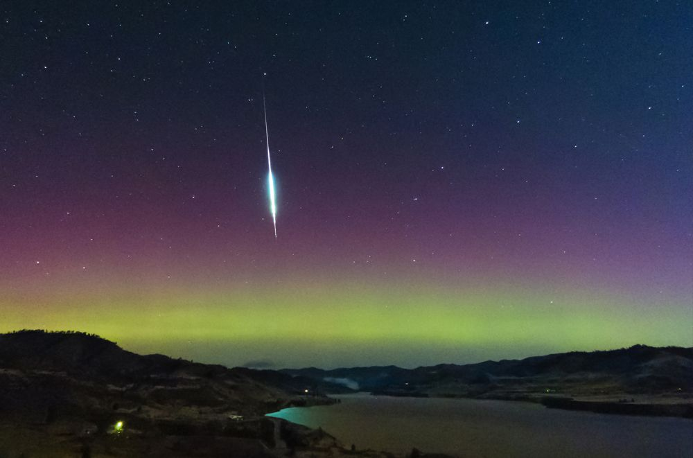 A taurid fireball and aurora in 2015 lighting up the night sky over the state of Washington.