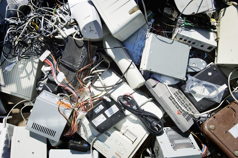 Pile of e-waste including old computers, wires, and more