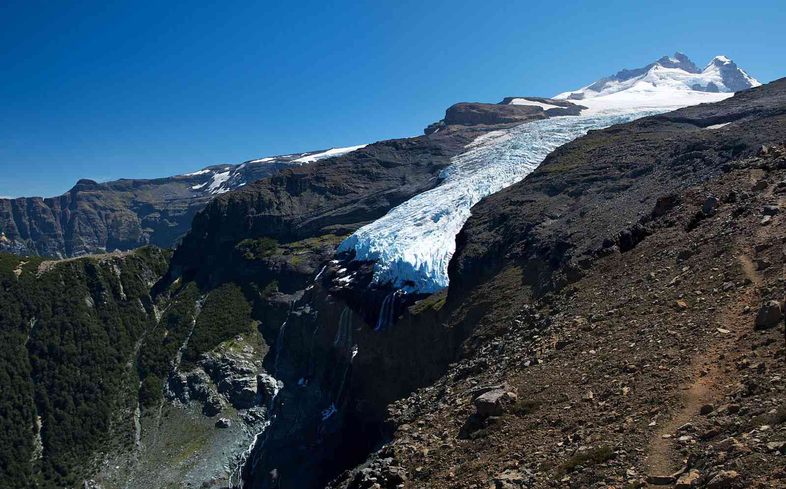 Hanging glaciers flow down mountainsides until they meet an abrupt end at a cliff's edge.