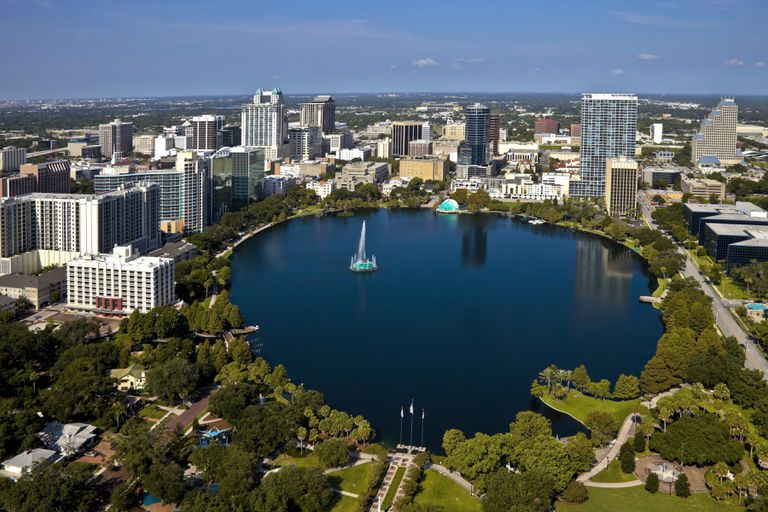 Aerial view of Lake Eola in foreground with Orlando skyline in background
