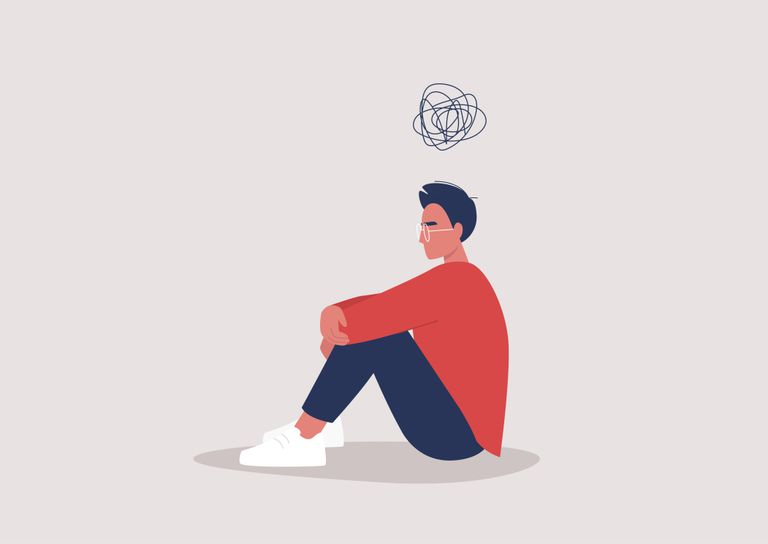 Young depressed male character sitting on the floor and holding their knees, a cartoon scribble above their head, mental health issues