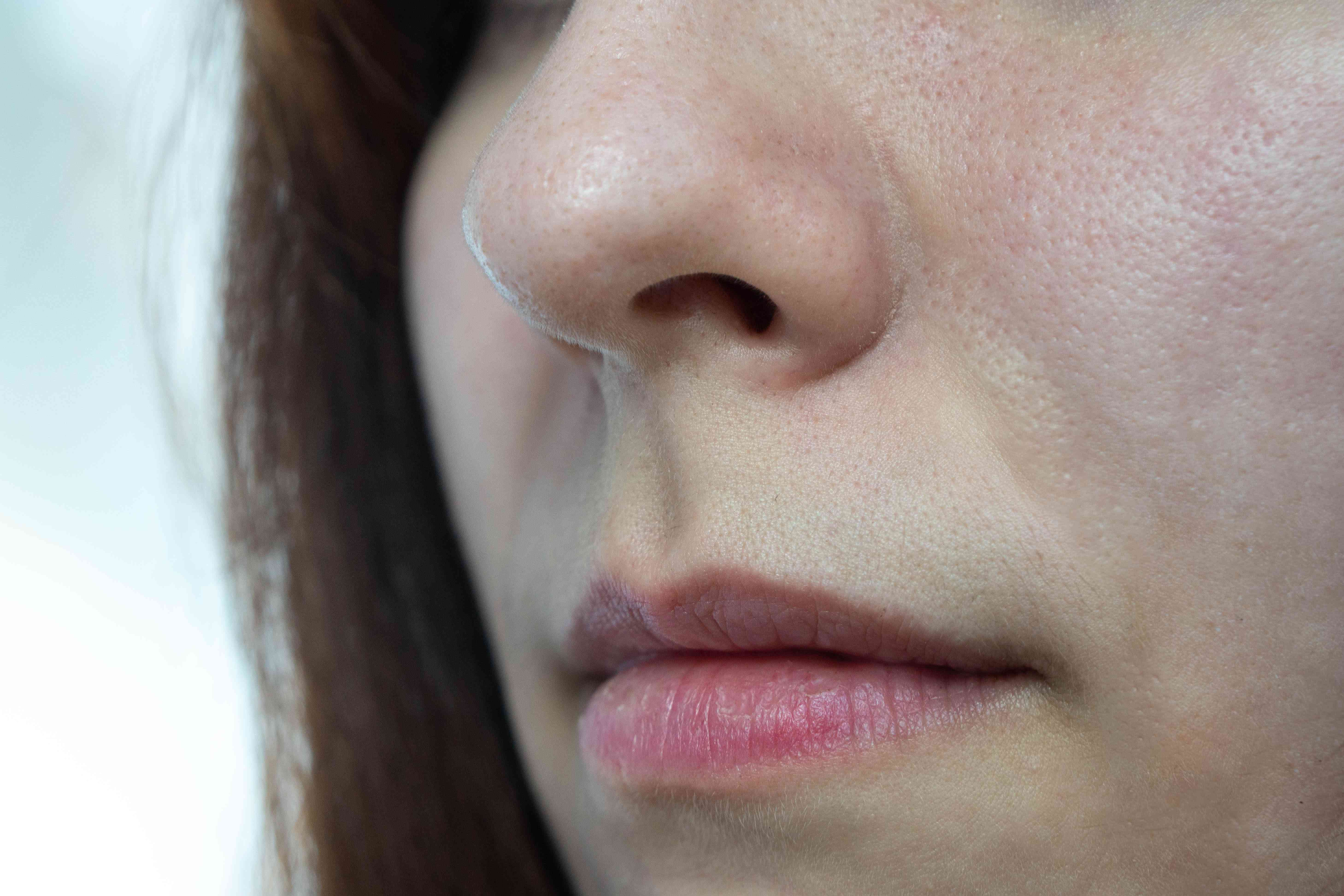 close shot of just woman's mouth and nose in 3/4 profile