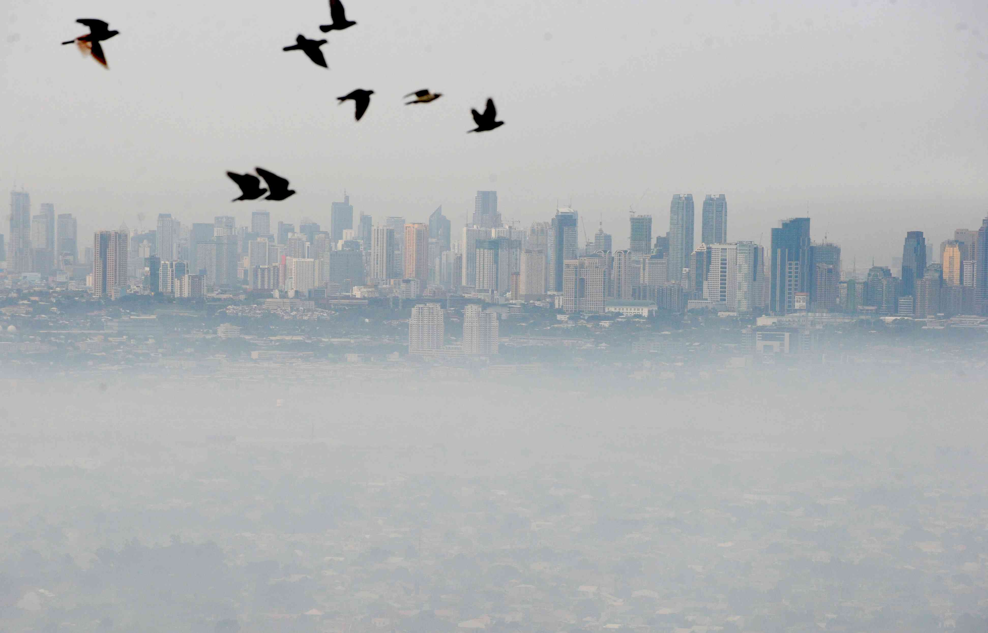 A thick blanket of smog covers Manila