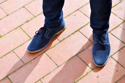 Blue Suede men's shoes on boardwalk